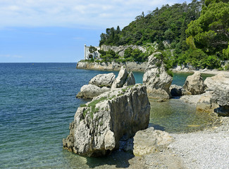 Coast and the entrance gate to the Miramare Castle near Trieste