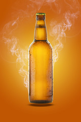 Bottle of beer with drops on orange background