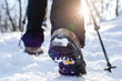 Winter hiking. Lens flare, shallow depth of field. - 75533345
