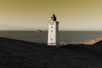 Leuchtturm und Paraglider