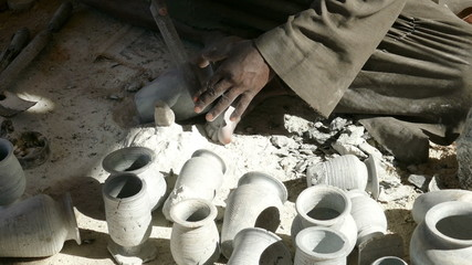 hands of a master, making the ceramic jug