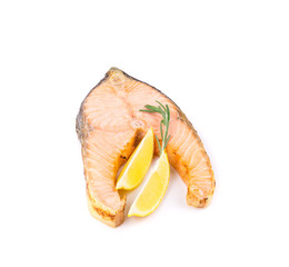 Fried salmon fillet with lemon.