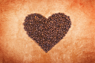 Roasted coffee beans in the shape of a heart.