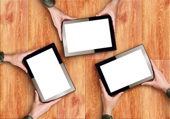 Hands Holding Three Digital Tablet Computers