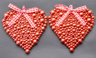Red shiny heart on a dark background