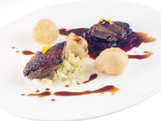 roast goose, red and white cabbage and dumplings