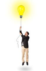 Happy man holding a light bulb balloon