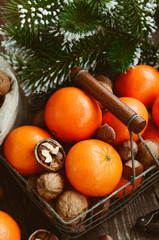 Xmas decoration wih tangerines, nuts and pine tree twigs