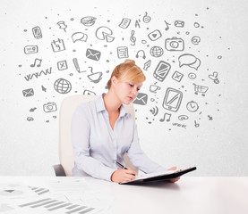 Young businesswoman with all kind of hand-drawn media icons in b