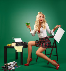 Pin-up girl sexy secretary near the typewriter