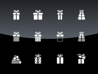 Christmas gift box icons on black background.