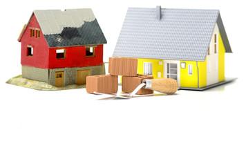 Haus mit Plan und Ziegelsteinen
