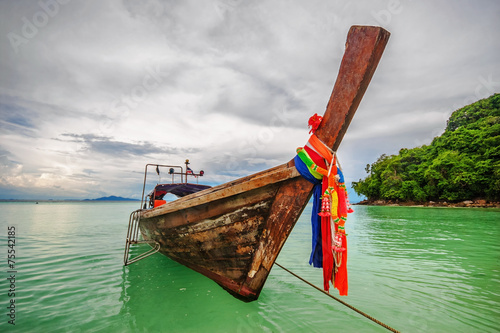 Boat in the tropical sea. - 75542185