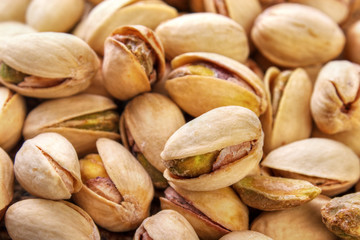 Salted and roasted pistachio nuts background