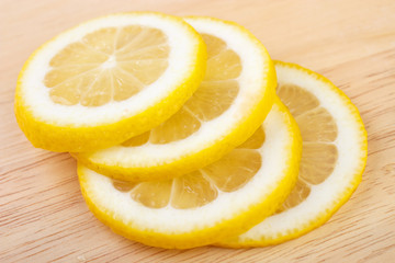 Juicy lemon slices on wooden table