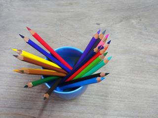 school supplies color pencils shavings on wooden board