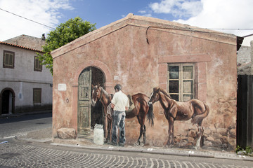 Murales di Tinnura in Sardegna: cavalli