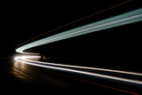 Fototapety Abstract blue, yellow and white rays of light in a car tunnel