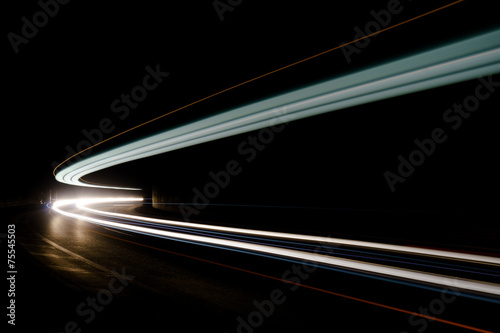 Abstract blue, yellow and white rays of light in a car tunnel