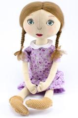 Rag doll girl dressed in pink