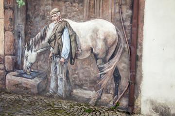 Murales di Tinnura in Sardegna: cavallo con fontana