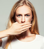 Woman with closed mouth