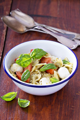 Pasta salad Caprese style with farfalle