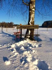 Sitzen im Schnee