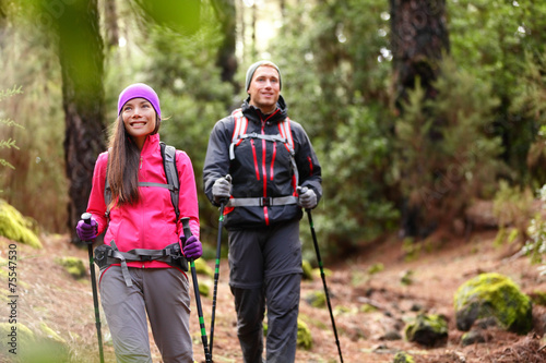 Hiker couple backpackers hiking in forest - 75547530