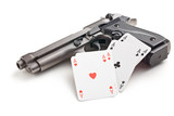 handgun and poker cards