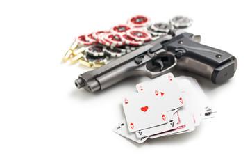 handgun and poker cards