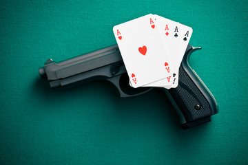 poker cards and handgun