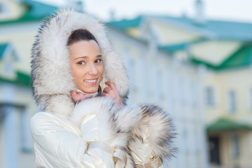 smiling beautiful woman in white coat