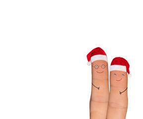 Fingers faces in Santa hats isolated on white background
