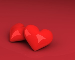two hearts over red background