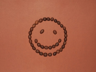 Smiling face made of coffee beans