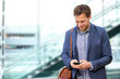 Young urban professional man using smart phone
