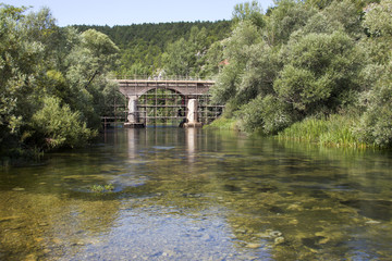 Renovation of ancient stone arch bridge over river Cetina