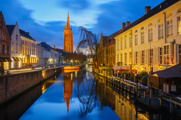 Cityscape with canal Dijver and a Church of Our Lady in Bruges a