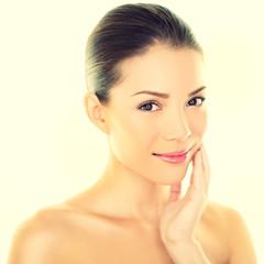 Woman beauty skincare woman touching skin on face
