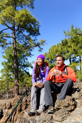 Hikers couple relaxing eating lunch hiking