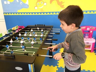 Child play foosball in playground