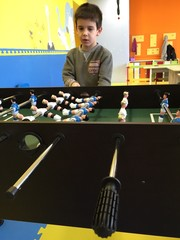 Child play foosball in playground
