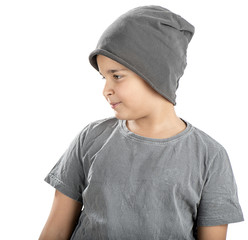 Cute boy wearing beanie looking at space for your text.