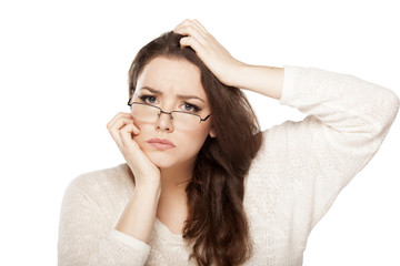 confused young woman scratching her head