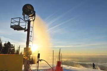 Snow Maker making snow at sunrise on Grouse Mountain