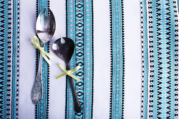Spoons on fabric background