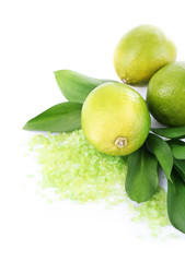 Fresh lime with sea crystals isolated on white