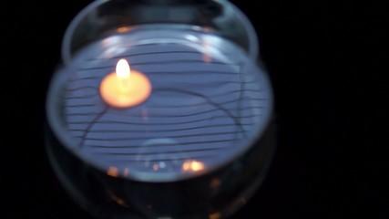 Burning candle in huge goblet