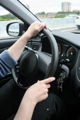 Female hands on wheel